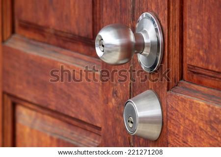 metal handle on a wooden door  - stock photo