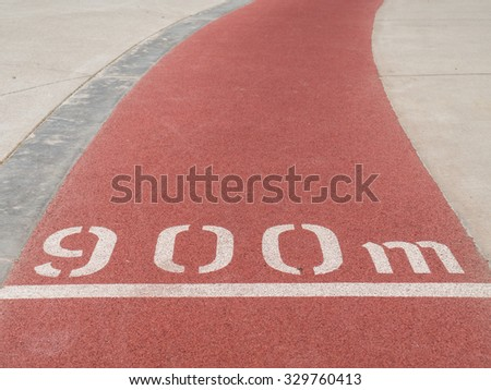 900 metre mark on a rubberised red running track.
