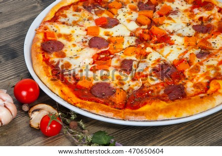 mexican pizza with mushrooms, salami, vegetables