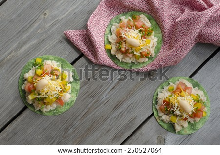 Mexican Pizzettes. tortillas with mashed white beans, tomatoes and bell peppers - stock photo