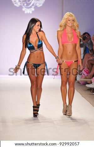 MIAMI BEACH, FL - JULY 18: Designer Jennifer Stano (L) walks the runway with model for Have Faith Swimwear during Mercedes-Benz Fashion Week Swim at The Raleigh on July 18, 2011 in Miami Beach, FL - stock photo