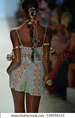 MIAMI, FL - JULY 20: A model walks the runway at the Mara Hoffman Swim show during Mercedes-Benz Fashion Week Swim 2014 at Cabana Grande at the Raleigh on July 20, 2013 in Miami, Florida.