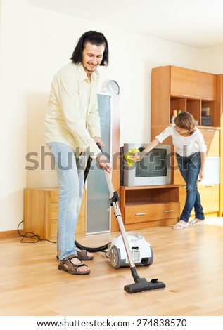 middle-aged couple doing housework  in home - stock photo