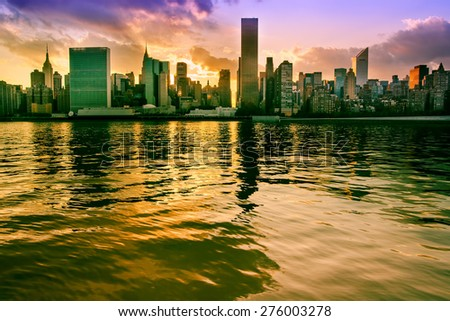 Midtown Manhattan, New York. View from Long Island City. Sunset scene.City lights. Urban living and transportation concept - stock photo