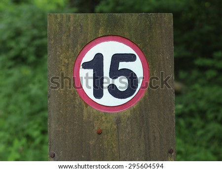 """""""15 Miles per Hour Speed Limit"""" Sign in Eggesford Forest, Devon, England, UK - stock photo"""