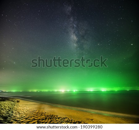 Milky Way rises over the sea - stock photo