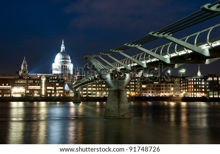 Millennium bridge and St. Paul cathedral in London at night - stock photo