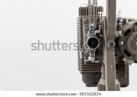 8 millimeter projector on white background - stock photo
