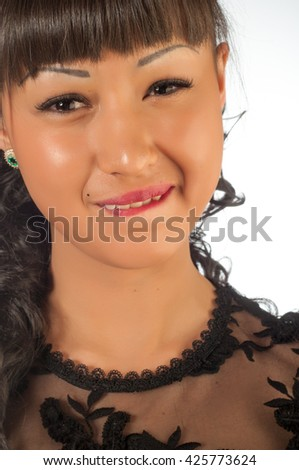 mimicry person. Portrait of a beautiful young woman with her eyes wide open, glancing sideways, she's looking completely shocked in the cutest manner possible. - stock photo