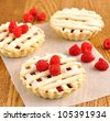 Mini pie with raspberry - stock photo