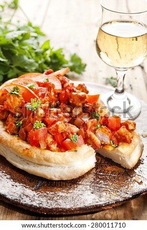 Mini puff pastry pizzas topped with tomatoes, veal and herbs  pastry pie,  with tomatoes, mini pizza  - stock photo
