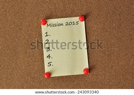 """""""MISSION 2015"""" on Yellow Note Paper With Red Push Pins On Board Backgroud - stock photo"""
