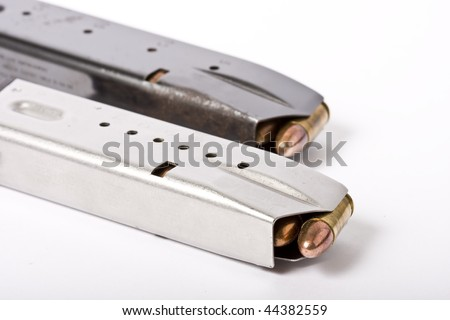 9mm ammunition in magazine clip - stock photo