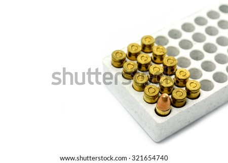 9 mm. bullet for a gun isolated on white background. - stock photo