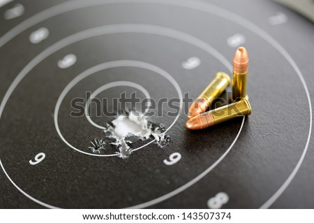 22 mm bullets and target shooting - stock photo