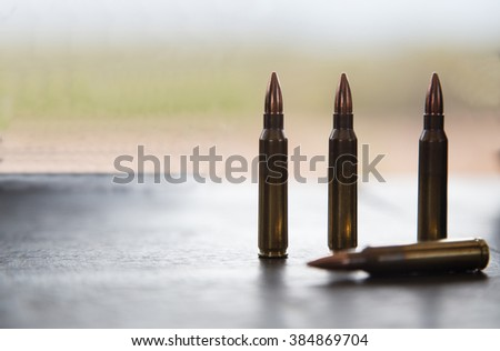 5.56 mm. bullets(for rifle) on the tables