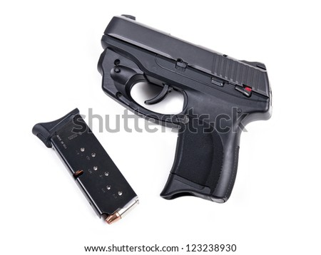 9mm Handgun isolated with a filled magazine. - stock photo