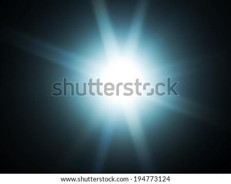 60mm lens flare on black background - stock photo