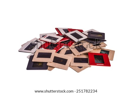 35 mm mounted film slides into the plastic and cardboard different colored frames isolated on white background, clipping path embedded - stock photo