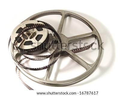 8mm movie film on plastic real, with metal take-up reel.  Isolated on white background.