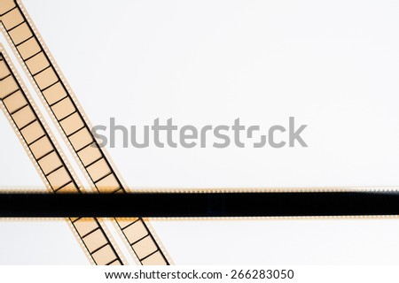 35 mm movie film stripes on white background, empty frame with copyspace - stock photo