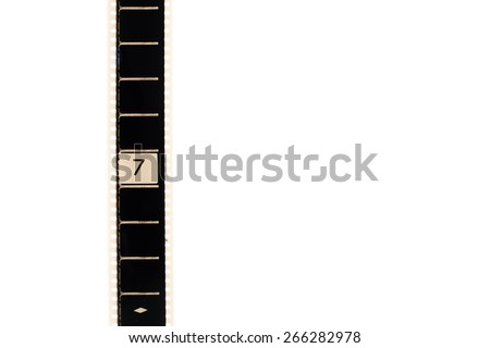 35mm movie film with number seven frame countdown, vertical and copyspace isolated on white background - stock photo