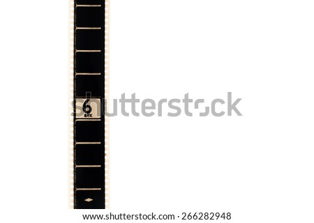 35mm movie film with number six frame countdown, vertical and copyspace isolated on white background - stock photo