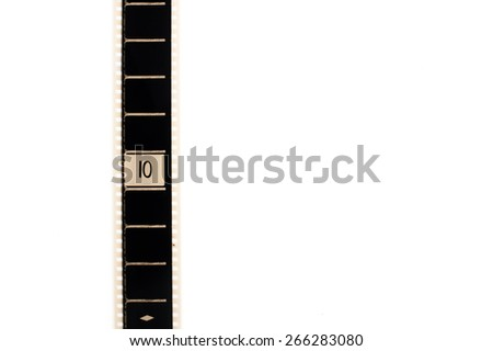 35mm movie film with number ten frame countdown, vertical and copyspace isolated on white background - stock photo