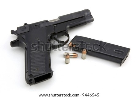 9mm pistol and ammo isolated on white background - stock photo