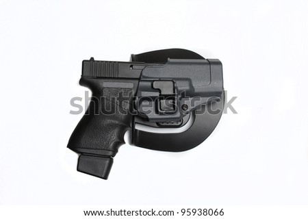 9mm pistol in a holster isolated on white