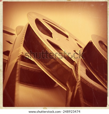 16 mm reel old movie film archive - stock photo