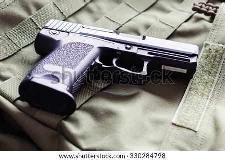 9mm x 19 semi-automatic pistol close-up, studio shot - stock photo