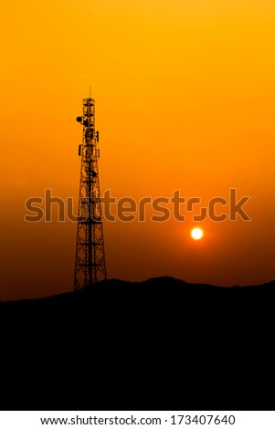 Mobile phone Telecommunication Radio antenna Tower. Cell phone tower with sunset sky, silhouette.