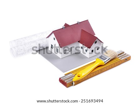 model house on a construction plan for house building, tools ,isolated white background - stock photo