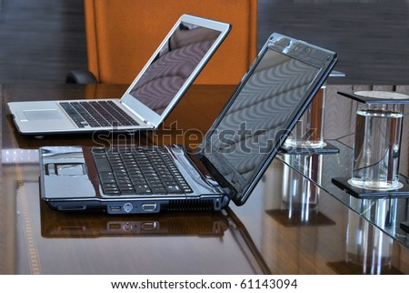 modern boardroom with laptops and yellow chair, close up - stock photo