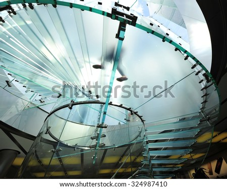 Modern glass stair outline walking man in Shanghai, China  - stock photo
