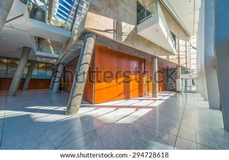 Modern lobby, hallway, plaza of the luxury center, hotel, shopping mall, business centre in Vancouver, Canada. Interior design. - stock photo
