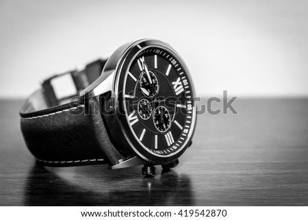 Modern men's watch in black and white - stock photo