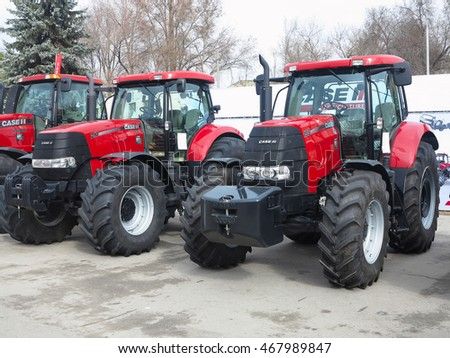 05.03.2016, Moldova, Chisinau: New red powerfull tractors at exhibition of agricultural machinery