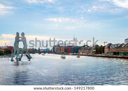 Molecule men with Tv tower in Berlin, Germany - stock photo