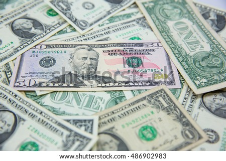 money american fifty dollar bills .Pile of various currencies isolated on white background.Closeup of assorted American banknotes.US currency scattered on the table.america currency.
