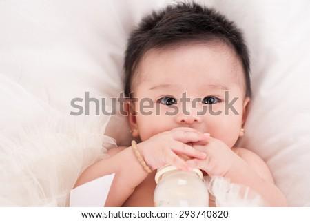 6 month baby milk eating bottle - stock photo