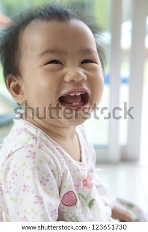 10 month baby with funny face in home living room - stock photo