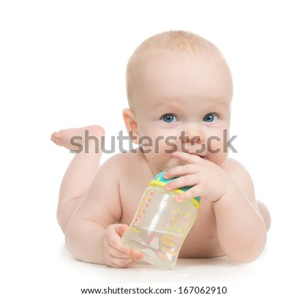 7 month child baby girl kid lying happy holding breastfeeding bottle nipple soother in hand looking at the corner on a white background
