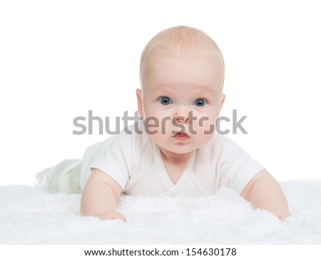 4 month infant child baby girl lying on bed and looking at the camera on a white background
