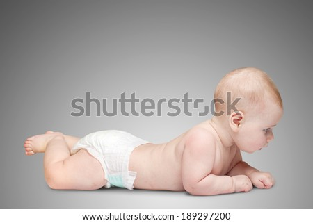 6 month infant child baby lying on a gray background