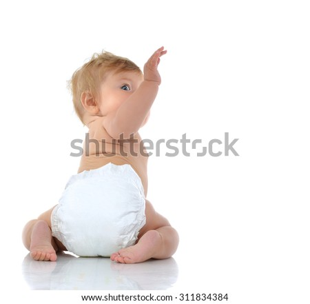 6 month infant child baby toddler sitting with raised hand up looking at the corner on a white background - stock photo