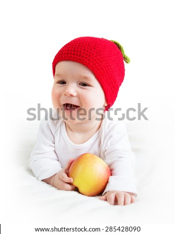 7 month old baby in apple hat - stock photo