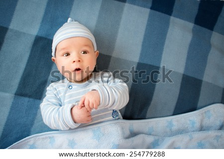 3 month old baby in the bed - stock photo