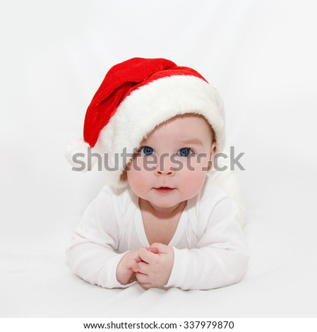 6 month old child wearing Santa's hat for Christmas - stock photo